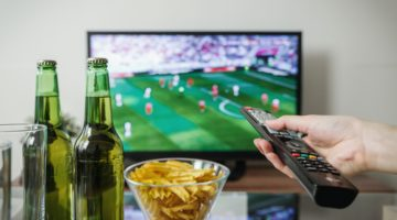 watching sport on tv with beer and snacks
